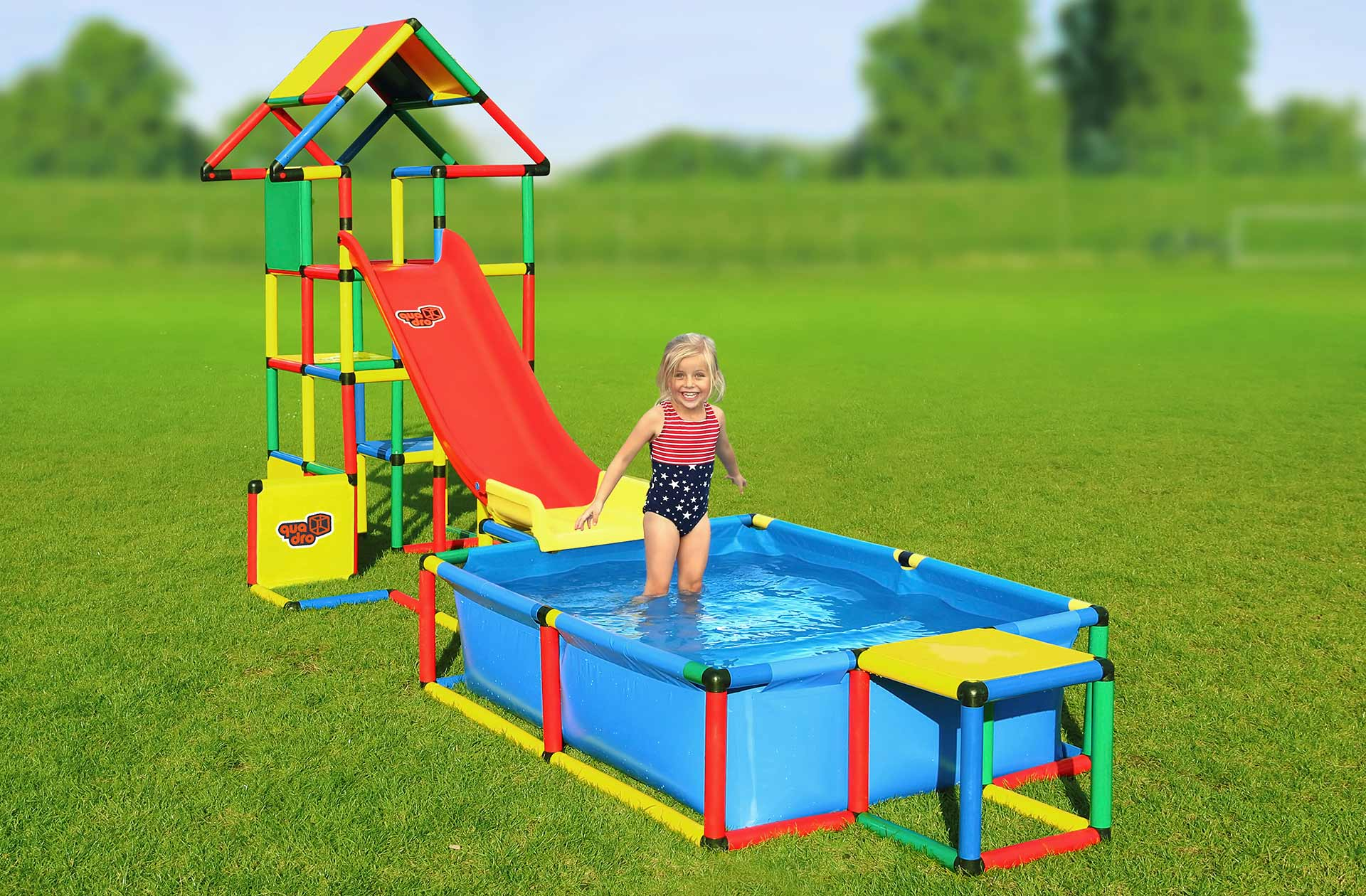 Girl in QUADRO pool with tower and slide