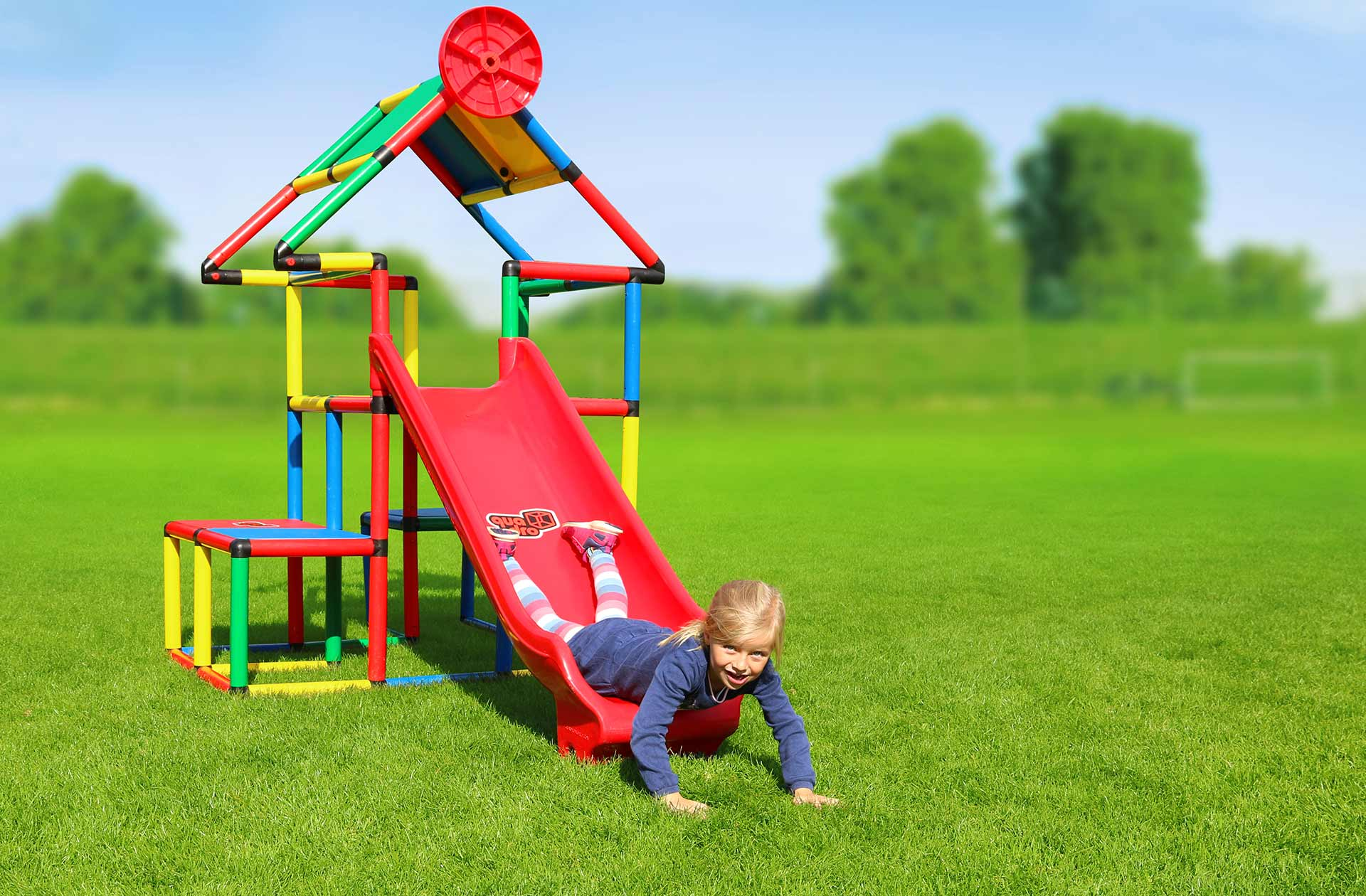 Kid sliding on QUADRO playhouse